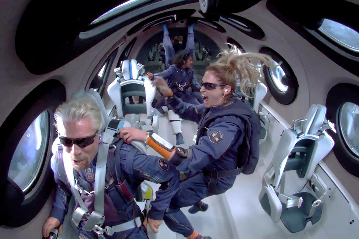 Virgin Galactic founder Richard Branson and crew members Beth Moses and Sirisha Bandla float in zero gravity on board Virgin Galactic's passenger rocket plane VSS Unity after reaching the edge of space above Spaceport America near Truth or Consequences, New Mexico, US, on 11 July. Photo: Reuters