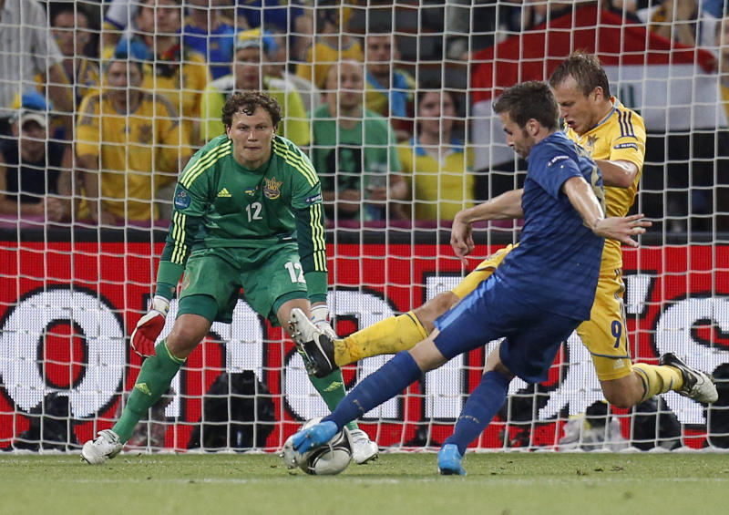 France's Yohan Cabaye scores his team's second goal by Ukraine goalkeeper Andriy Pyatov and Oleh Gusev during the Euro 2012 soccer championship Group D match between Ukraine and France in Donetsk, Ukraine, Friday, June 15, 2012. (AP Photo/Efrem Lukatsky)