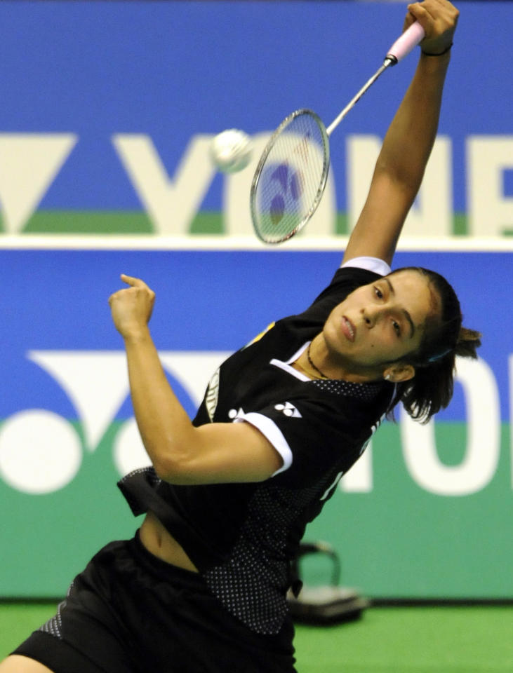 Fourth-seeded Saina Nehwal of India smashes the shuttlecock towards Inthanon Ratchaanok of Thailand during their women's singles first round match at the Japan Open badminton championships in Tokyo on September 21, 2011. Nehwal won the match 21-17, 21-10.      AFP PHOTO / TOSHIFUMI KITAMURA (Photo credit should read TOSHIFUMI KITAMURA/AFP/Getty Images)