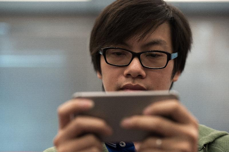"""Tencent will roll out a system across its mobile game titles allowing the company to check if the player is underage and should be included in its """"anti-obsession"""" system (AFP Photo/NICOLAS ASFOURI)"""