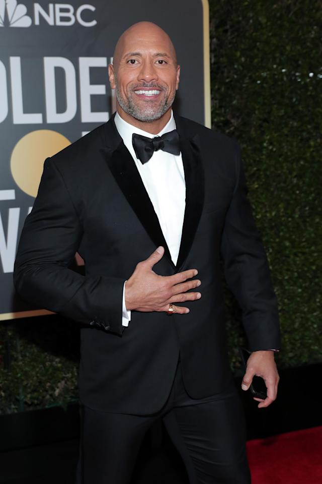 Everybody wanted to meet the Rock at the 2018 Golden Globes. (Photo: Getty Images)
