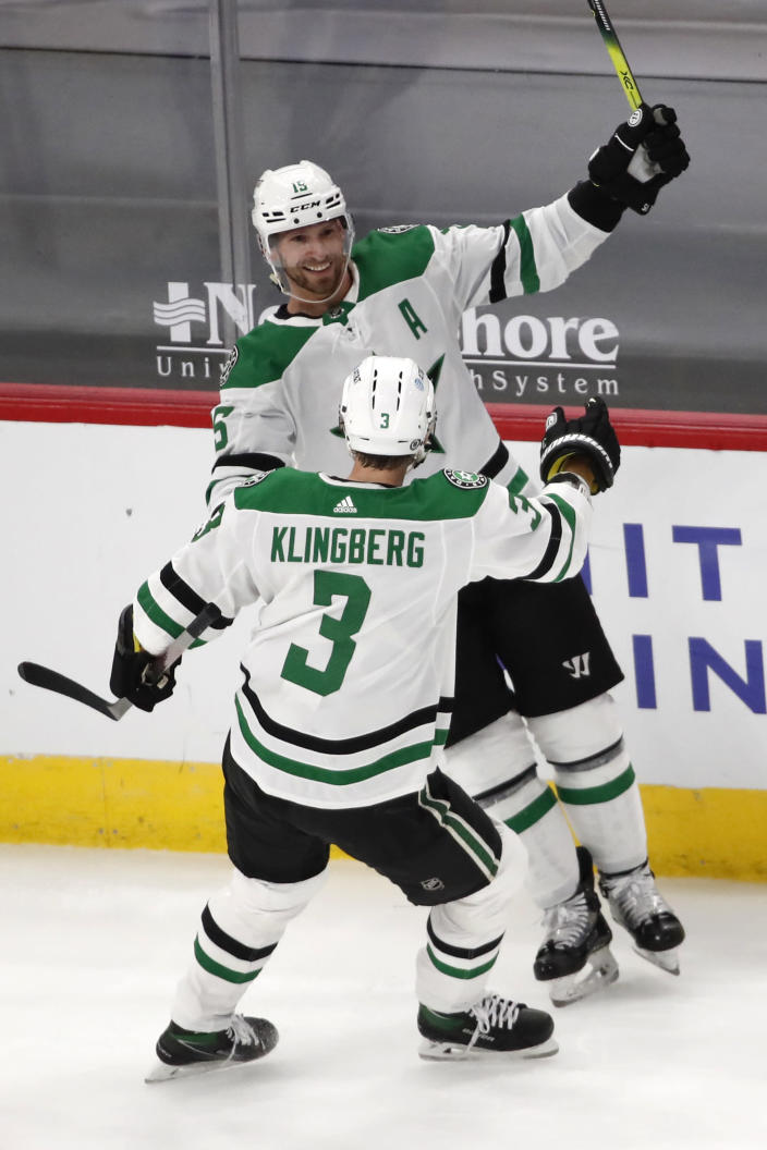 Dallas Stars left wing Blake Comeau (15) celebrates his goal with John Klingberg (3) during the second period of the team's NHL hockey game against the Chicago Blackhawks on Thursday, April 8, 2021, in Chicago. (AP Photo/Jeff Haynes)