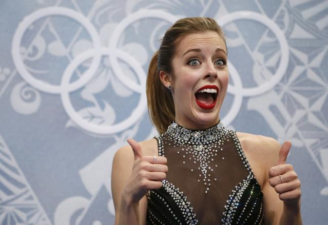 """Ashley Wagner of the U.S. reacts in the """"kiss and cry"""" area during the Figure Skating Women's Short Program at the Sochi 2014 Winter Olympics"""