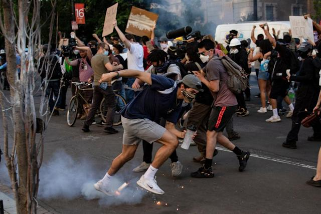 "<span class=""element-image__caption"">A tear gas canister lands at the feet of protestors near the White House.</span> <span class=""element-image__credit"">Photograph: Samuel Corum/EPA</span>"