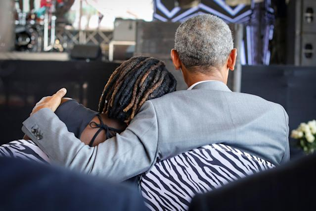<p>Former US president Barack Obama (R) holds his half-sister Auma Obama (L), during an opening ceremony of the Sauti Kuu Sports, Vocational and Training Centre in his ancestral home Kogelo, some 400km west of the capital Nairobi, Kenya on July 16, 2018. (Photo: Dai Kurokawa/EPA-EFE/REX/Shutterstock) </p>