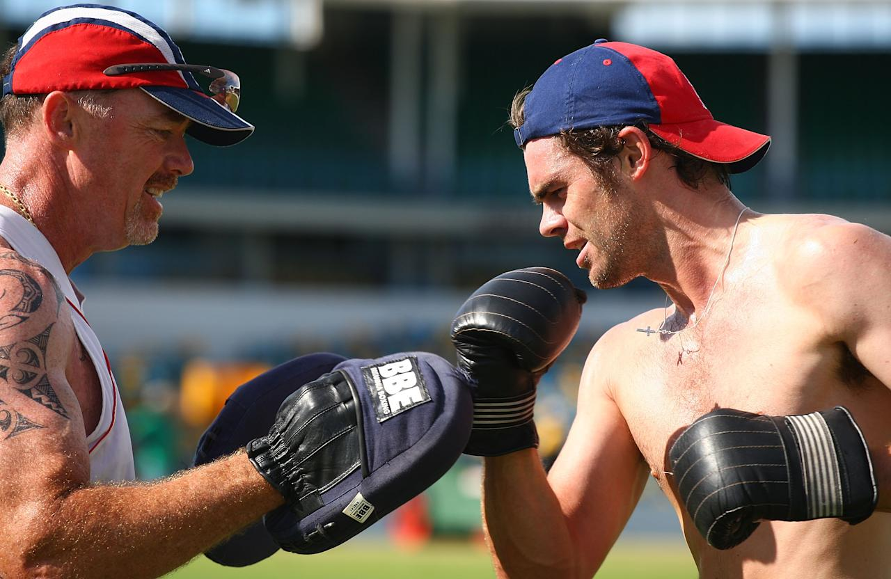BRIDGETOWN, BARBADOS - MARCH 24:  England cricketer James Anderson (R) boxes with Reg Dickason during a fitness training morning at The Kensington Oval on March 24, 2009 in Bridgetown, Barbados.  (Photo by Julian Herbert/Getty Images)
