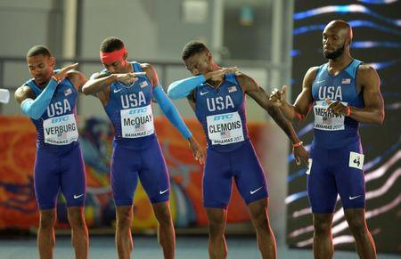 Apr 23, 2017; Nassau, Bahamas; Members of the United States 4 x 400m relay pose as they are introduced during the IAAF World Relays at Thomas A. Robinson Stadium. From left: David Verburg and Tony McQuay and Kyle Clemons and LaShawn Merritt. Mandatory Credit: Kirby Lee-USA TODAY Sports