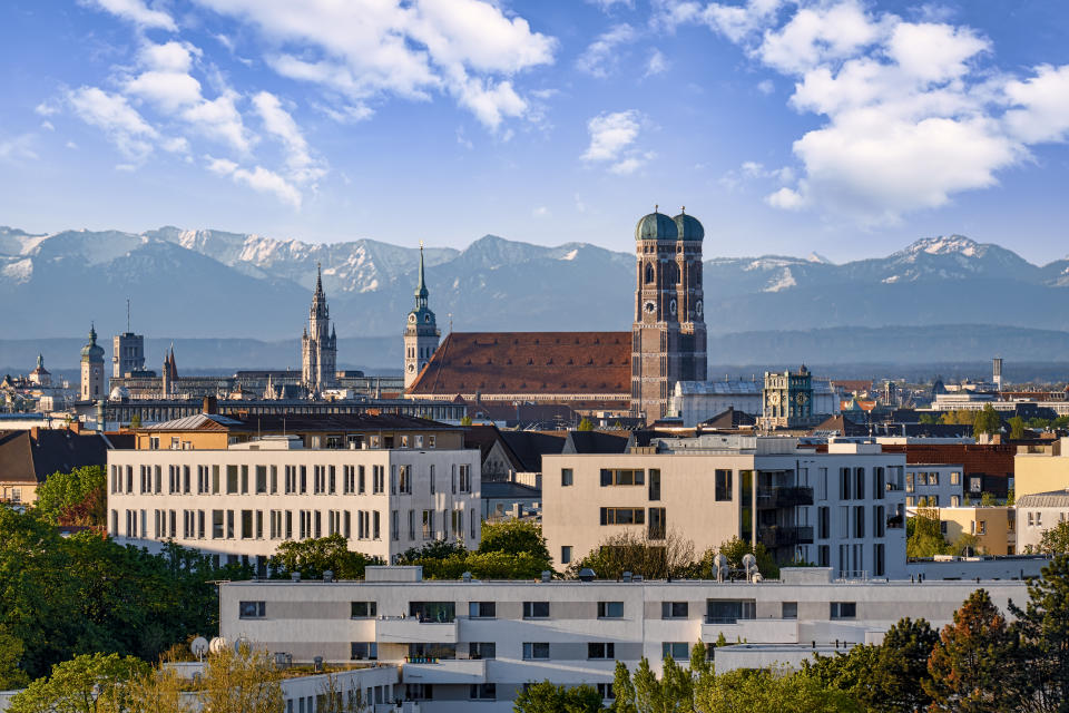 Munich's Old Town Hall against the Bavarian Alps. (Photo: Gettyimages)
