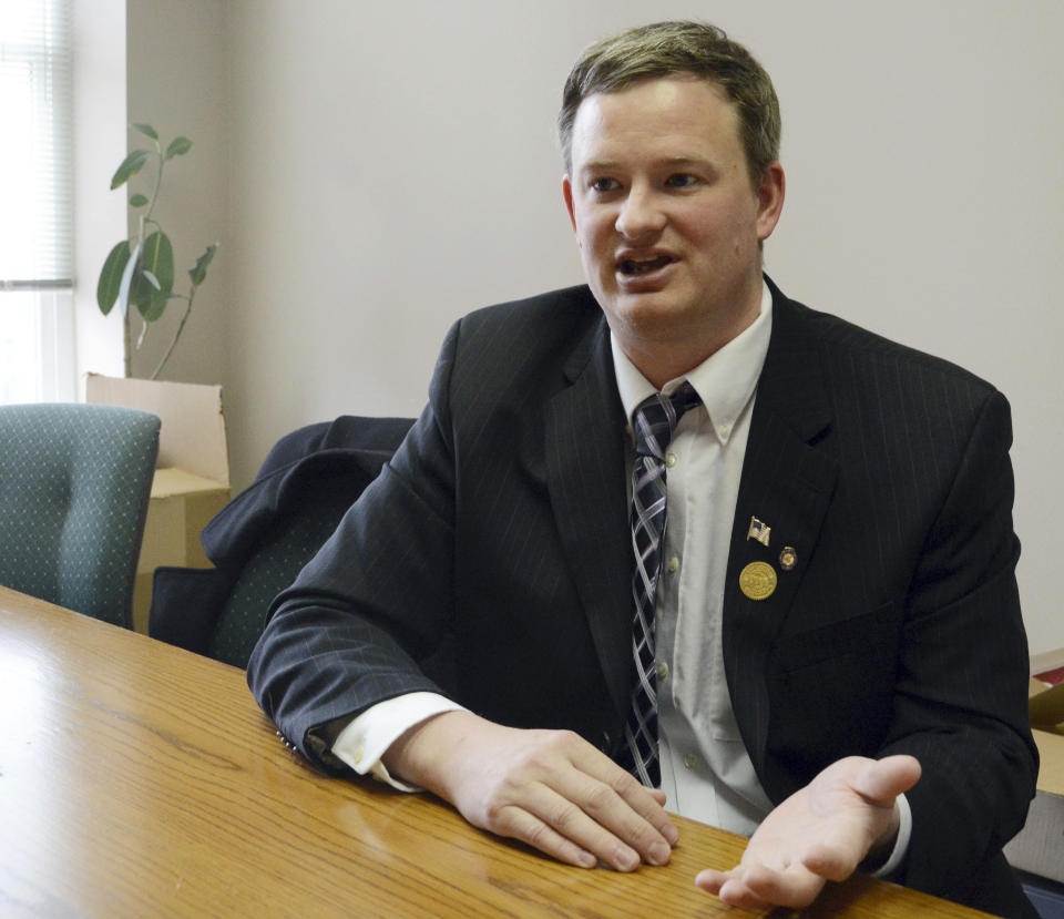 FILE - In this Feb. 23, 2014, file photo, Jason Ravnsborg speaks in Sioux Falls, S.D. Ravnsborg, South Dakota's Republican attorney general, has been charged with misdemeanor careless driving after he struck and killed a man with his car, authorities said Thursday, Feb. 18, 2021. (AP Photo/Dirk Lammers, File)