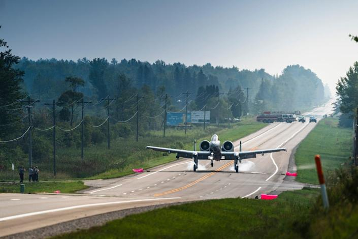 An A-10 on highway in Michigan