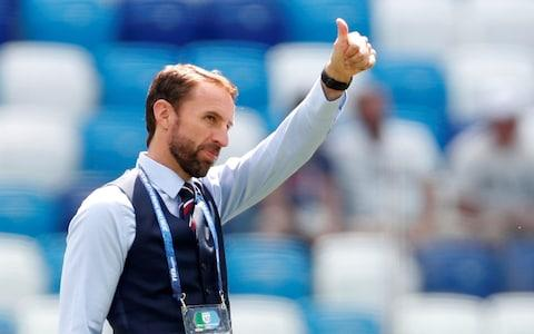 Gareth Southgate acknowledges the England supporters before the game - Credit: REUTERS/Matthew Childs