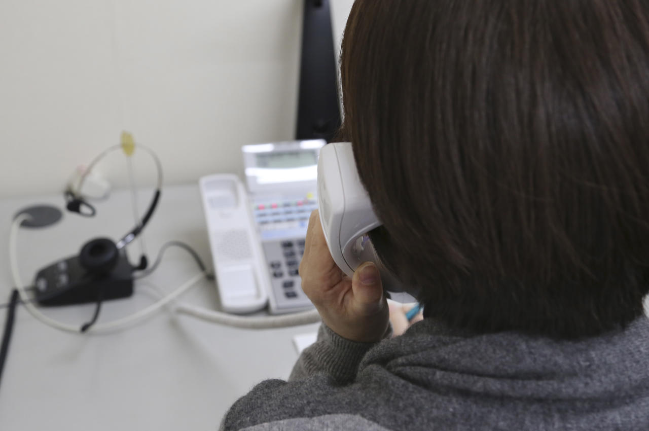 "In this March 15, 2017 photo, a staff of ""Inochinodenwa,"" non-profit telephone hotline for people seek help, receives a counseling call in Tokyo. Fewer Japanese are taking their own lives, a glimmer of hope in a country with one of the world's highest suicide rates. The number of suicides has dropped for seven straight years in a clear indication of a downward trend. The Health Ministry said Thursday, March 23, 2017, that 21,897 people committed suicide in 2016, down from more than 30,000 in 2011. (AP Photo/Koji Sasahara)"