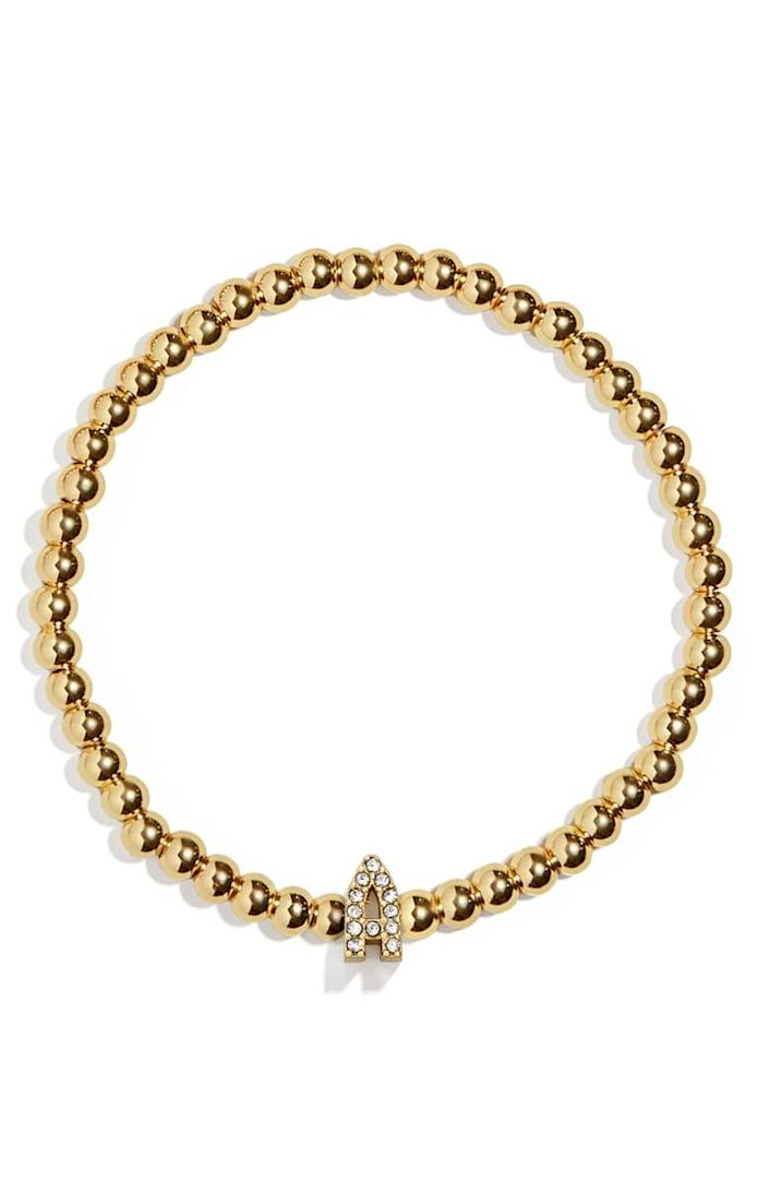<p>This personal <span>Baublebar Pisa Pavè Initial Bracelet</span> ($28) makes for a great gift.</p>