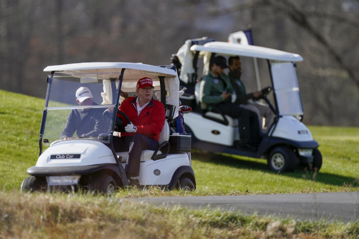 President Donald Trump drives a golf cart as he plays golf at Trump National Golf Club, Saturday, Nov. 28, 2020, in Sterling, Va. (AP Photo/Alex Brandon)