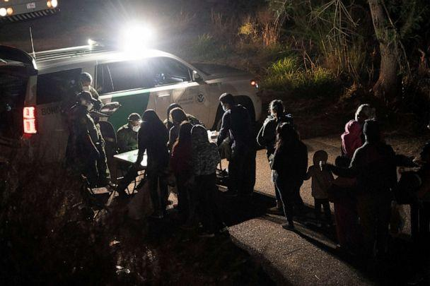 PHOTO: Asylum-seeking migrants' families wait to be transported by the U.S. Border Patrol after crossing the Rio Grande river into the United States from Mexico, April 22, 2021 in Roma, Texas. (Go Nakamura/Getty Images)