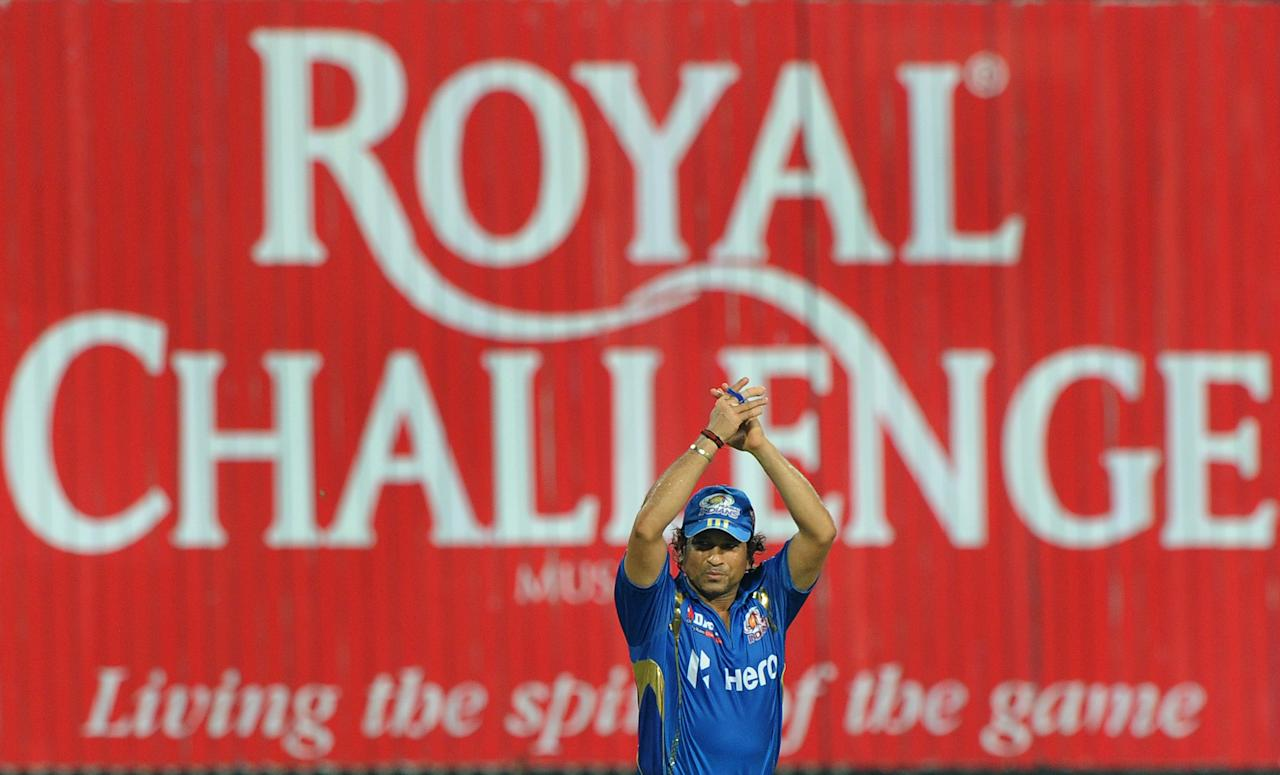 Mumbai Indians cricketer Sachin Tendulkar celebrates his team's win after the IPL Twenty20 cricket match between Kolkata Knight Riders and Mumbai Indians at The Eden Gardens in Kolkata on May 12, 2012.  RESTRICTED TO EDITORIAL USE. MOBILE USE WITHIN NEWS PACKAGE.  AFP PHOTO/Dibyangshu SARKAR        (Photo credit should read DIBYANGSHU SARKAR/AFP/GettyImages)