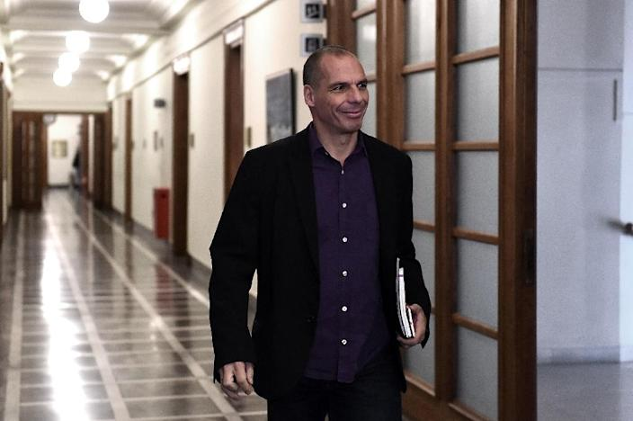 Greek Finance Minister Yanis Varoufakis arrives for a ministerial meeting at parliament in Athens on February 24, 2015 (AFP Photo/Aris Messinis)