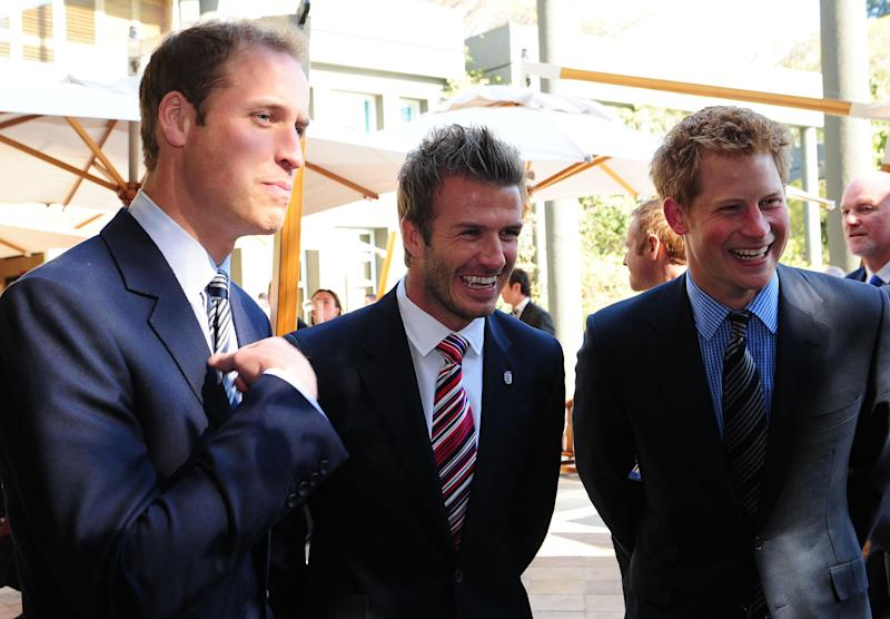 Prince William (left) and Prince Harry flank David Beckham at a reception in Johannesburg onJune 19, 2010, in honor of the 2010 Football FIFA World Cup. (Photo: Owen Humphreys - PA Images via Getty Images)