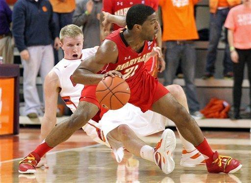 Clemson's Tanner Smith, left, falls backwards after fouling Maryland's Pe'Shon Howard in the second half of their NCAA college basketball game on Tuesday, Feb. 7, 2012 in Clemson, S.C. (AP Photo/Anderson Independent-Mail, Mark Crammer) GREENVILLE NEWS, SENECA JOURNAL - OUT