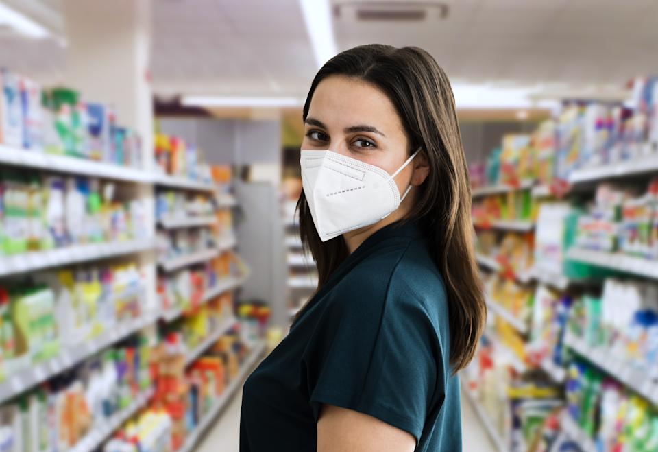 Young Customer Woman Shopping In Face Mask