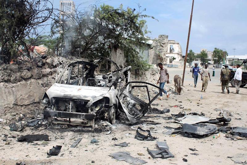 The scene in Mogadishu on August 31, 2014 following a car bomb and gun attack against an intelligence headquarters and detention facility (AFP Photo/)