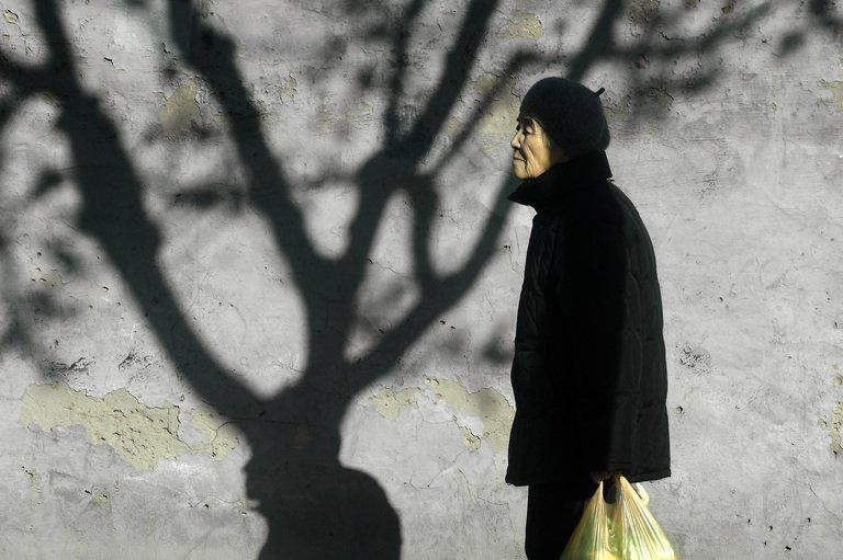 An elderly woman, pictured in Beijing, on November 26, 2012