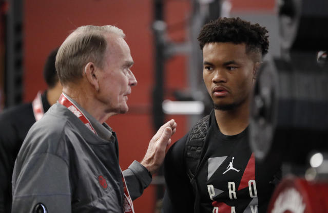 Oklahoma football staff member Merv Johnson, left, talks to Oklahoma quarterback Kyler Murray before Murray goes through drills at the university's Pro Day for NFL scouts in Norman, Okla., Wednesday, March 13, 2019. (AP Photo/Alonzo Adams)