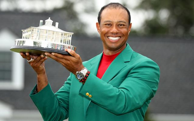 Tiger Woods celebrates winning his first green jacket since 2005 - REUTERS