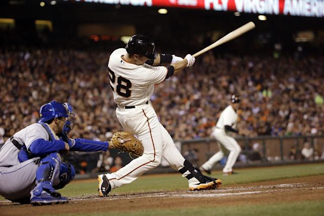 San Francisco Giants' Buster Posey drives in a run with a single against the Los Angeles Dodgers during the third inning of a baseball game Wednesday, April 16, 2014, in San Francisco. (AP Photo/Marcio Jose Sanchez)
