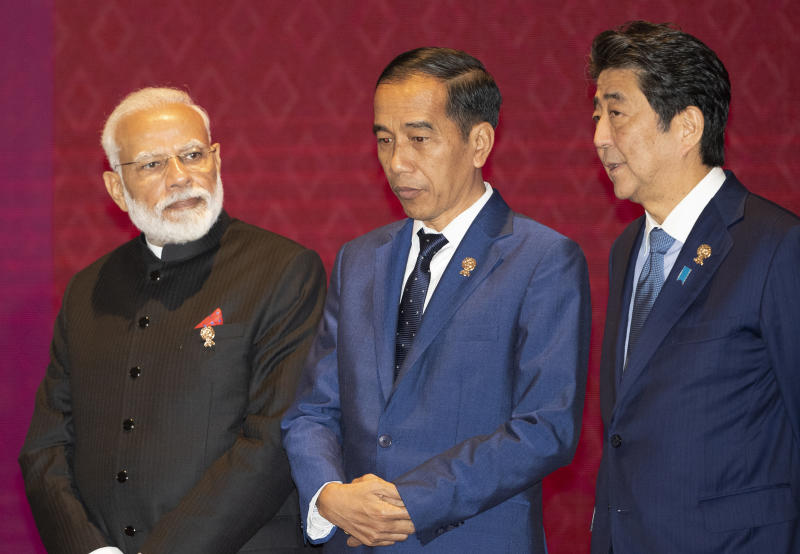 From Left to Right; India's Prime Minister Narendra Modi, Indonesia's President Joko Widodo, and Japan's Prime Minister Shinzo Abe talk before a group photo during the East Asia summit in Nonthaburi, Thailand, Monday, Nov. 4, 2019. (AP Photo/Sakchai Lalit)