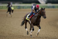Kentucky Derby entrant Helium works out at Churchill Downs Wednesday, April 28, 2021, in Louisville, Ky. The 147th running of the Kentucky Derby is scheduled for Saturday, May 1. (AP Photo/Charlie Riedel)
