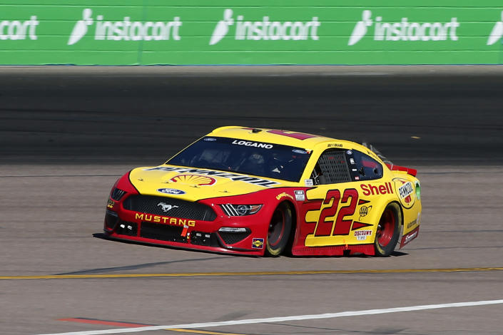 Joey Logano races out of Turn 2 during a NASCAR Cup Series auto race at Phoenix Raceway, Sunday, March 14, 2021, in Avondale, Ariz. (AP Photo/Ralph Freso)