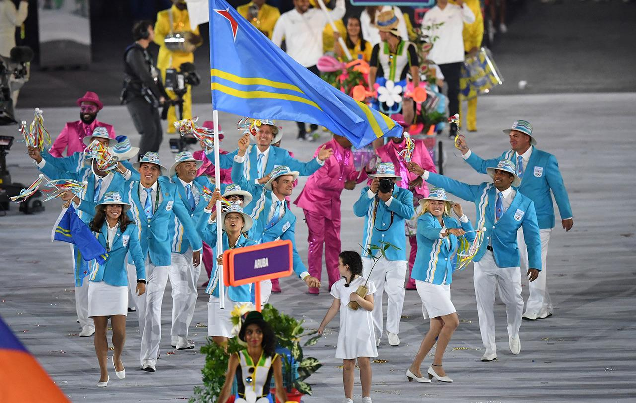<p>The duck egg-blue jackets with stark white pants were a little too Club Med meets Carnival. </p><p><i>(Photo: Getty Images)</i> </p>