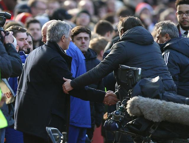 Mourinho (left) and Conte shake hands at Old Trafford