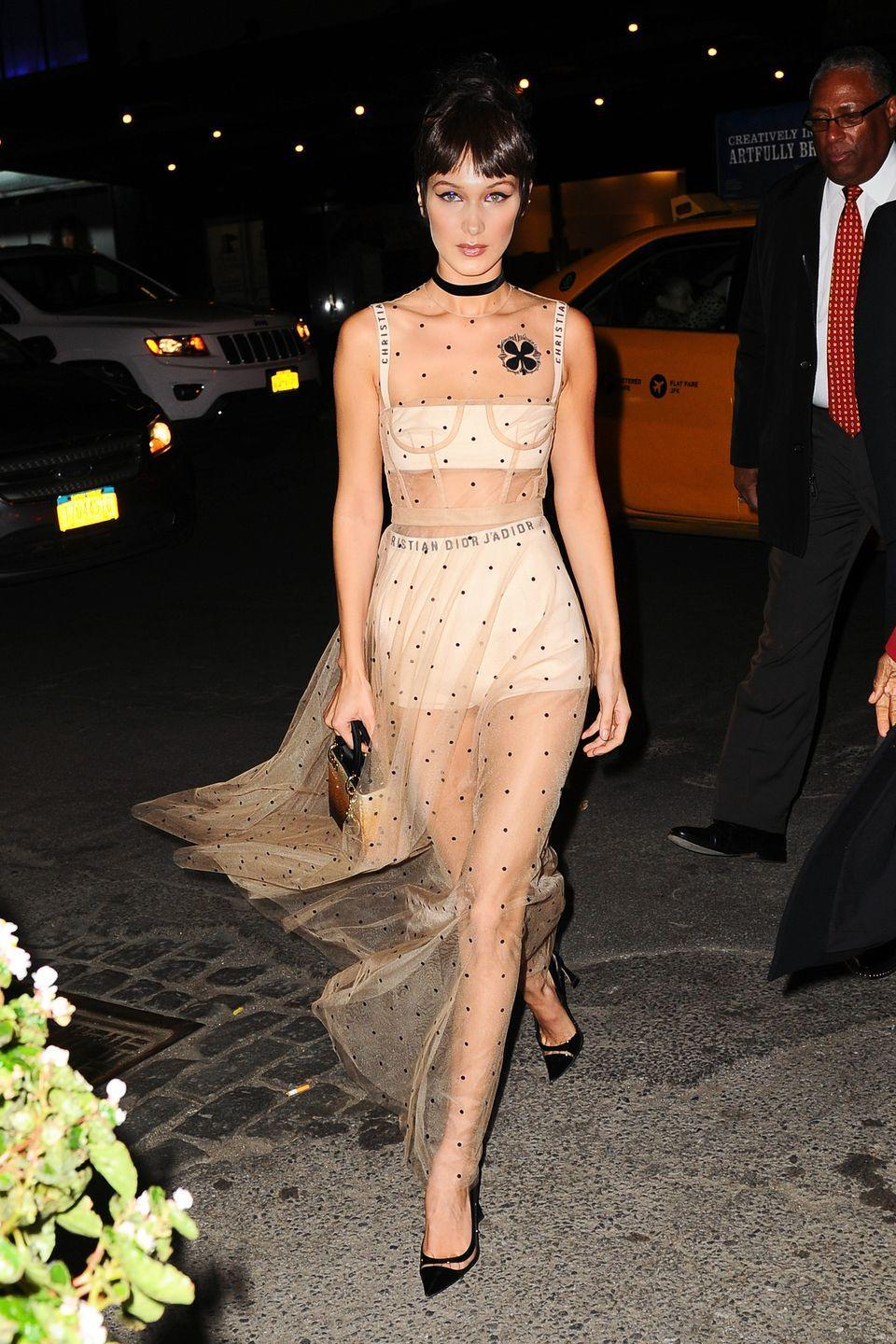 <p>In a sheer Dior Spring 2017 dress with a black choker, ombre handbag and pointed-toe pumps while out in NYC.</p>