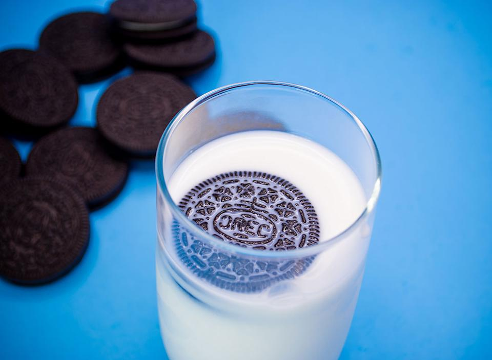Oreo floating in a cup of milk