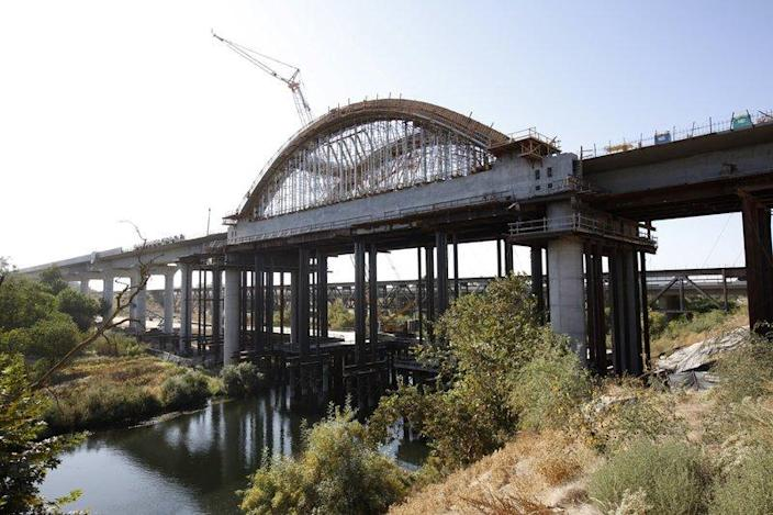 This Oct. 9, 2019 file photo shows the high speed rail viaduct under construction over the San Joaquin River near Fresno, Calif. The California High-Speed Rail Authority is bumping its overall cost estimate for completing the rail line between San Francisco and Los Angeles to more than $80 billion.
