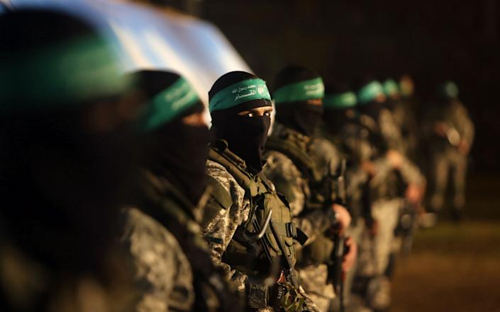 Palestinian members of the Ezzedine al-Qassam Brigades, the armed wing of the Hamas movement, take part in a gathering on January 31, 2016 - AFP