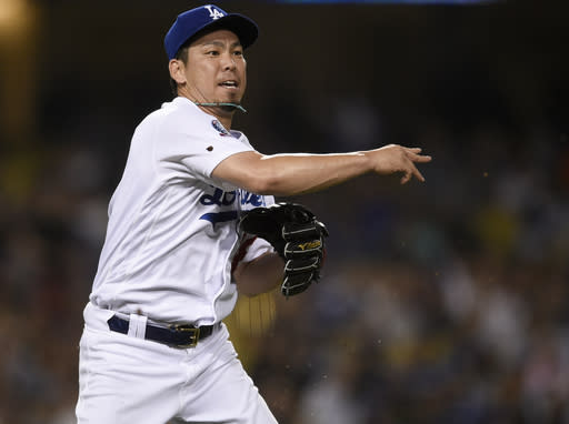 Los Angeles Dodgers pitcher Kenta Maeda throws to first base to force out New York Mets' Michael Conforto during the eighth inning of a baseball game in Los Angeles, Monday, Sept. 3, 2018. (AP Photo/Kelvin Kuo)