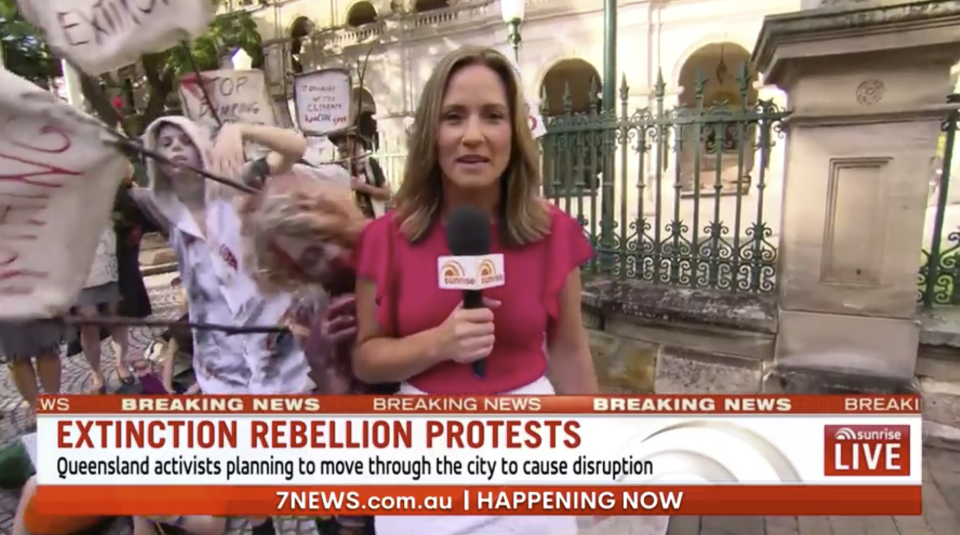 Queensland correspondent Bianca Stone was covering the climate change protest when the the zombies, who are part of the group Extinction Rebellion, began interrupting her cross. Photo: Seven