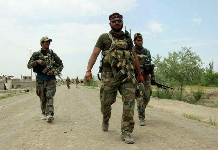 Members of Afghan commando unit arrive at the Qala-i-Zal, the district to the northwest of Kunduz, Afghanistan