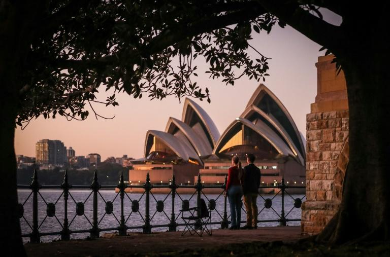 Restrictions on travel, public gatherings and retail businesses have had a devastating impact on the economy in Australia (AFP Photo/DAVID GRAY)