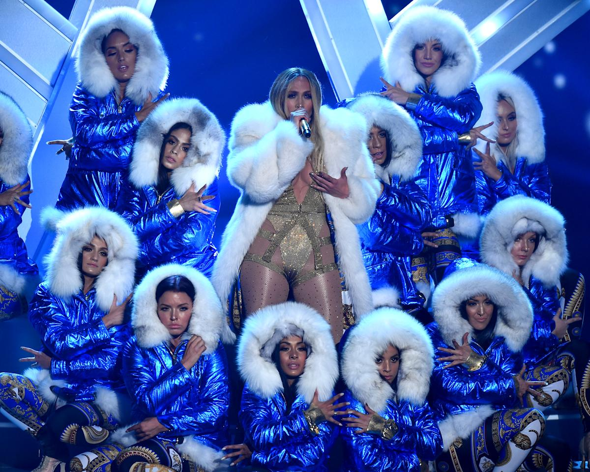 "<p>Lopez slowed things down for her rendition of her hit song ""All I Have."" Adding a white fur coat, the singer and her backup dancers sported winter jackets, similar to the outfits worn in the single's 2002 music video. </p>"