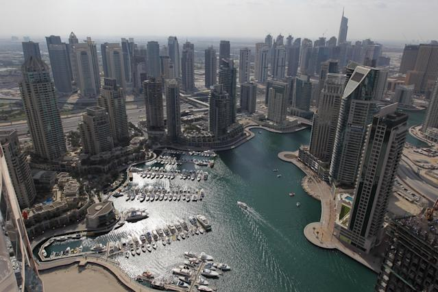 DUBAI, UNITED ARAB EMIRATES - DECEMBER 03: A general view of Dubai Marina on December 3, 2009 in Dubai, United Arab Emirates. Stock markets in the Dubai and Abu Dhabi fell sharply this week after state owned company Dubai World asked for more time to pay off depts, amounting to 35Bn GBP. The Dubai economy which has enjoyed years of rapid growth has seen a sharp decline recently as world markets reacted to the global economic crisis (Photo by David Rogers/Getty Images)