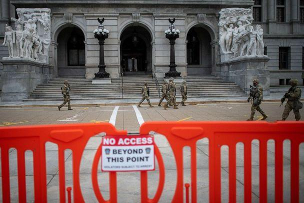 PHOTO: Members of the National Guard patrol outside the Pennsylvania Capitol Building on Jan. 17, 2021, in Harrisburg, Pa. (Mark Makela/Getty Images)
