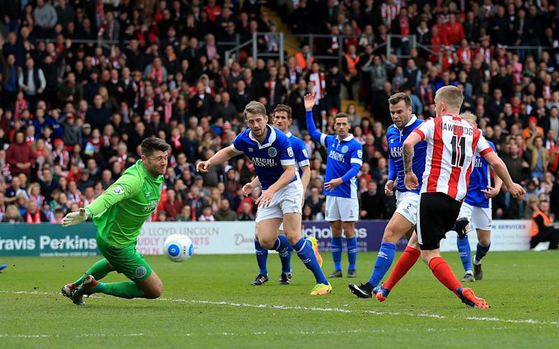 FA Cup heroes Lincoln City end dream season with promotion back into Football League - Credit: PA