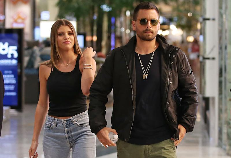 Sofia Richie and Scott Disick in the street