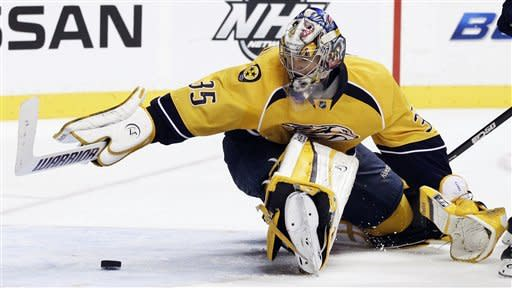 Nashville Predators goalie Pekka Rinne, of Finland, dives to make a stop against the Colorado Avalanche in the third period of an NHL hockey game on Thursday, March 8, 2012, in Nashville, Tenn. (AP Photo/Mark Humphrey)