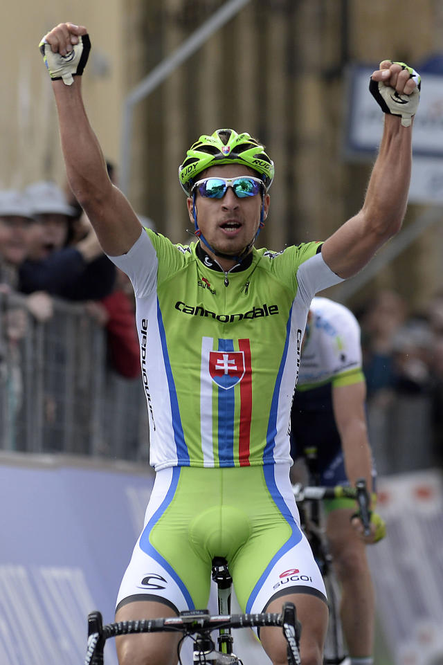 Slovakia's Peter Sagan celebrates as he crosses the finish line to win the third stage of the Tirreno Adriatico cycling race from Cascina to Arezzo Italy, Friday, March 14, 2014. Peter Sagan showed off his uphill sprinting skills to win the third stage of the weeklong Tirreno-Adriatico race Friday, and Michal Kwiatkowski took the overall lead. Sagan, a Slovak who rides for the Cannondale team, won in 5 hours, 10 minutes, 17 seconds on the 212-kilometer (132-mile) leg from Cascina to the Tuscan town of Arezzo. (AP Photo/Fabio Ferrari, Lapresse)