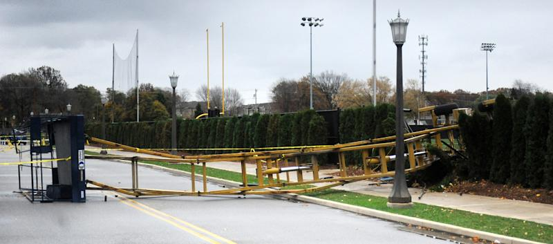 In this Oct. 28, 2010, photo, a hydraulic scissor lift lies on its side near the Notre Dame football field in South Bend, Ind. Declan Sullivan, 20-year-old junior from Long Grove, Ill., died Wednesday, Oct. 27, 2010, in South Bend, Ind., after the tower he was in while videotaping football practice toppled as high wind gusts swept through Indiana. (AP Photo/The Notre Dame Observer, Sam Werner) MANDATORY CREDIT, NO SALES